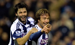 Diego Lugano of West Bromwich Albion celebrates his equalising goal with Claudio Yacob.