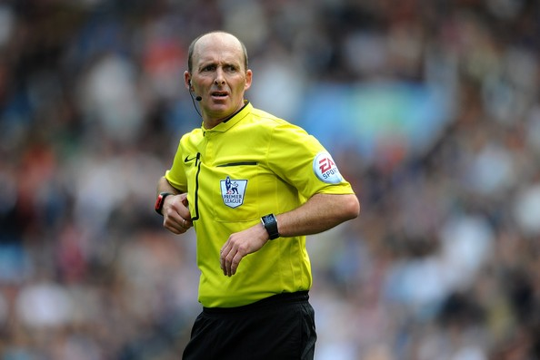 In the middle: Dean will take charge of a Man City v Chelsea Premier League fixture for the third time