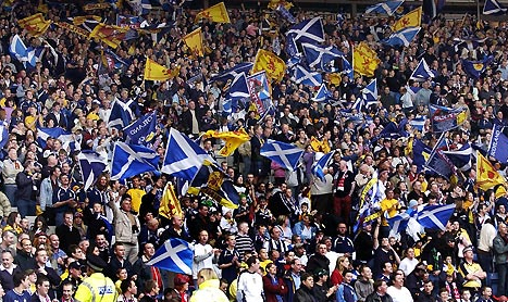 Support band: Almost 40,000 Scotland fans flocked into Ibrox to see their country in action against Georgia
