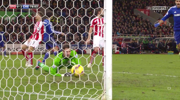 Scuffed: The shot was tame and mishit but Fabregas still found the back of the Stoke net