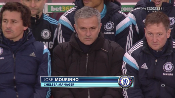 Up and down: Mourinho switched between a seated and standing view of the action throughout