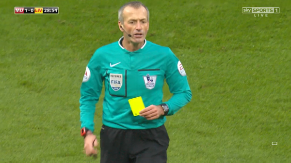 Martin Atkinson with yellow card