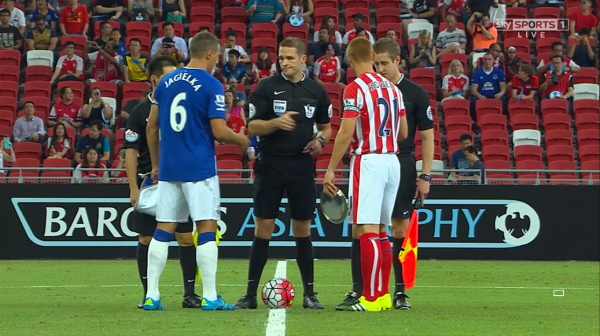 Craig Pawson conducts coin toss (Everton v Stoke BAT 15th July 2015)