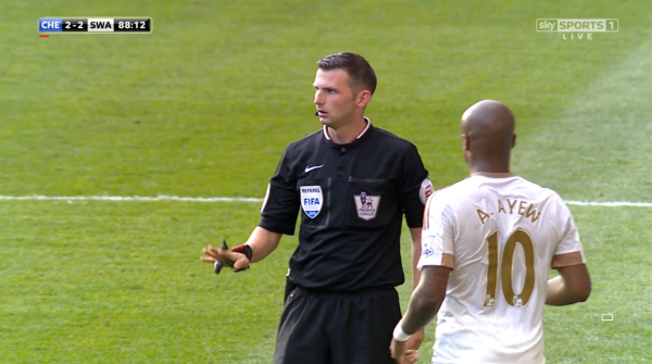 Michael Oliver and Andre Ayew (Chelsea v Swansea - 8th August 2015)