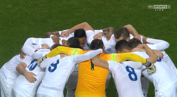 England players form pre-match huddle at Celtic Park (18th Nov 2014)