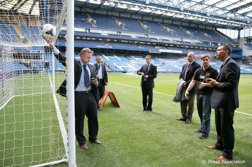 Referee Jon Moss testing goal-line technology