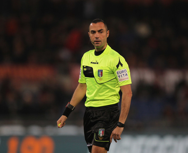 Referee Marco Guida looks on